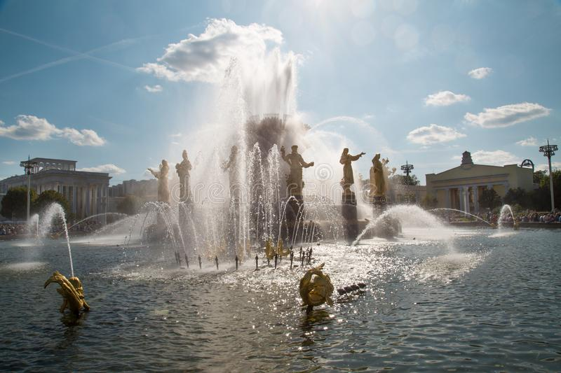 The fountain of Friendship of peoples at Exhibition of achievements of the national economy VDNH in the sunlight on a Sunny day. Moscow attractions of World stock photos