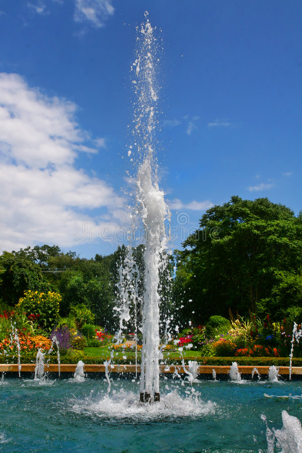 Fountain in a Garden stock images