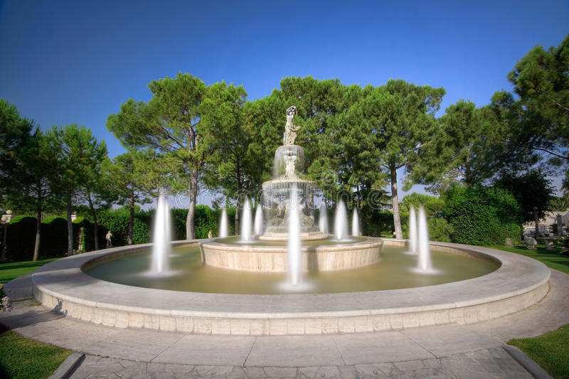 Download Fountain in the Garden stock photo. Image of squirt, bush - 9848624
