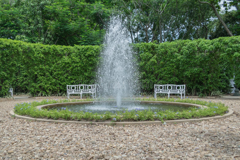 Fountain in the garden center stock image