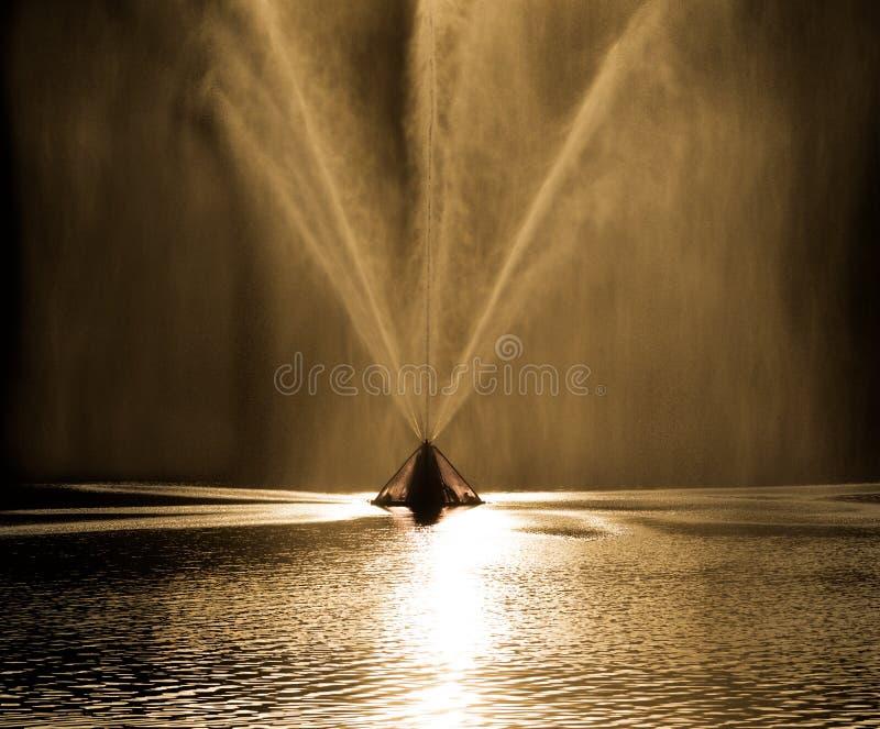Fountain on golden sunset hours stock photo
