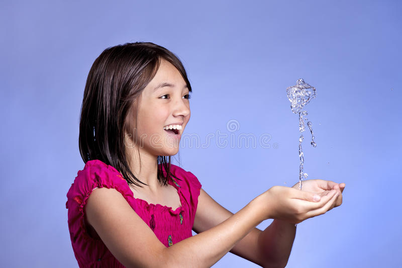Fountain from the hands. stock photography