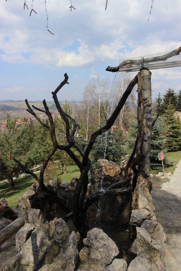 Fountain inside Vila Bran. Bran (German: Törzburg; Hungarian: Törcsvár) is a commune in Brașov County, Romania. It lies at 30 km from the city of royalty free stock photos