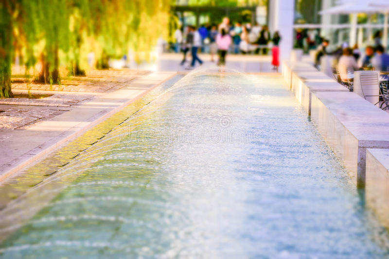 Fountain. Long fountain shot wth tilt-shift royalty free stock images