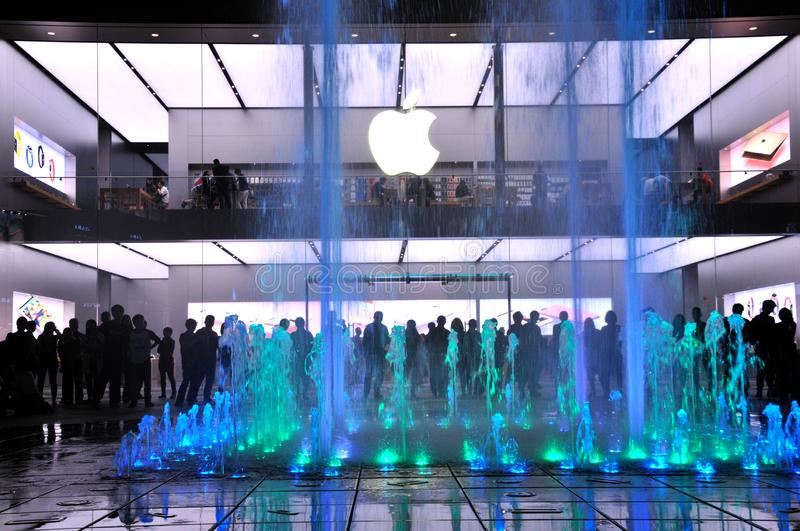 The fountain at the Mall. The modern city in particular. Night lights and the visitors around the fountain at at the Apple Store Chunxi Road in Chengdu, China royalty free stock images