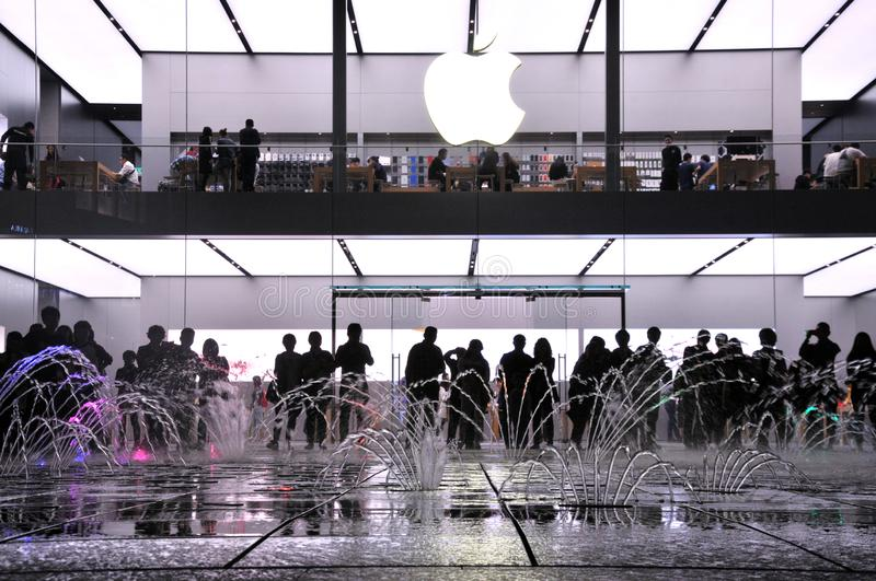 The fountain at the Mall. The modern city in particular. Night lights and the visitors around the fountain at at the Apple Store Chunxi Road in Chengdu, China stock photo