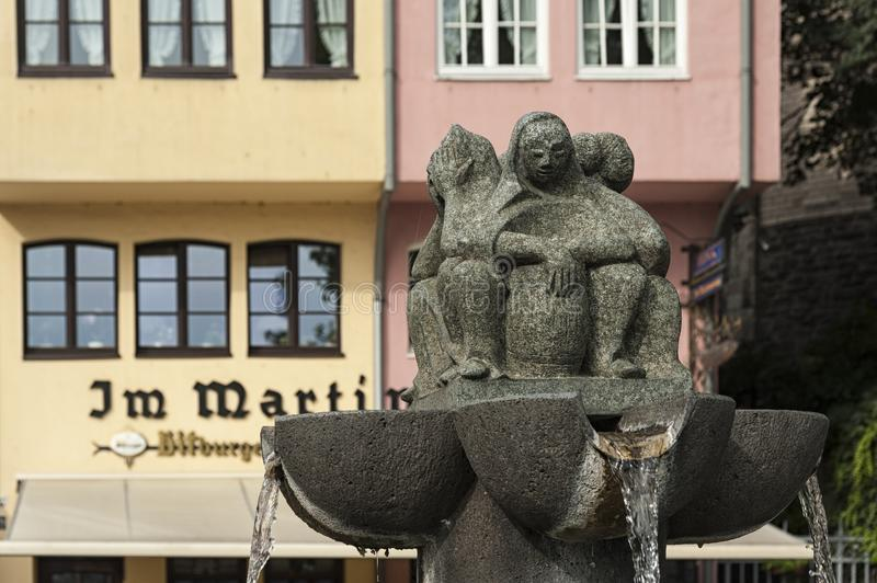 Fountain near the colorful German historical houses in Bavarian style in the old town of Cologne stock photography