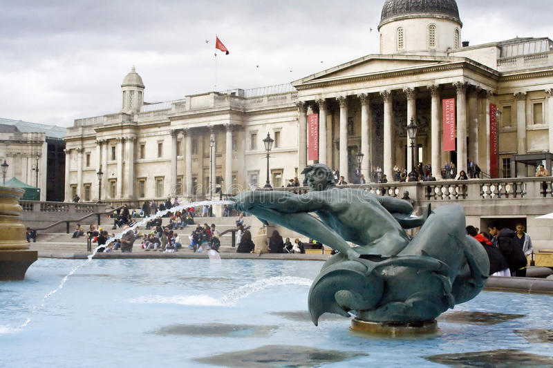 Fountain near National Gallery in London. The dolphin fountain near the National Gallery in London, UK royalty free stock photography