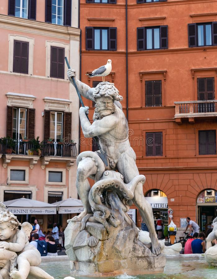 Fountain of Neptune in the Piazza Navona - Rome, Italy. Rome, Italy - June 11 2019: Close-up of Neptune sculpture in Fountain of Neptune at the Piazza Navona royalty free stock images