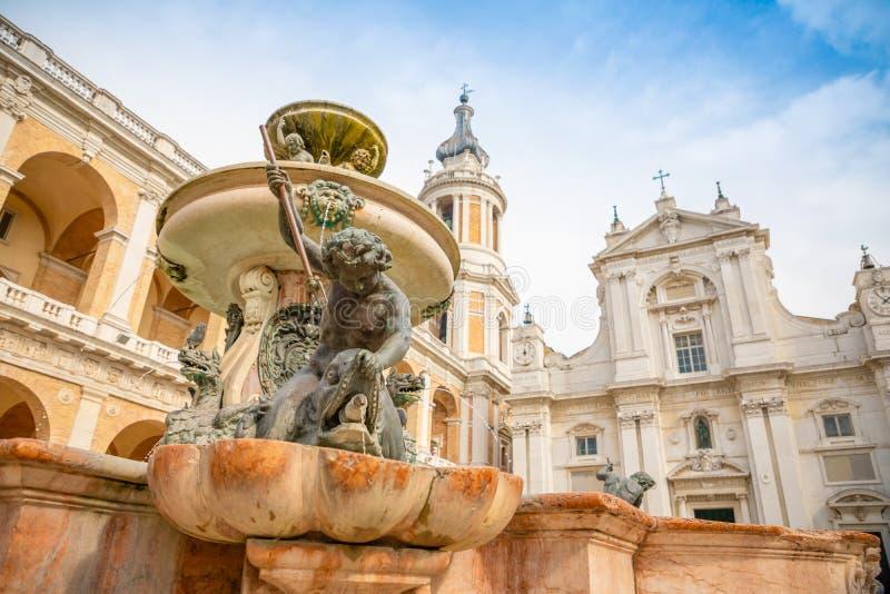 Fountain next to Loreto Basilica della Santa Casa in sunny day, Italy stock photo