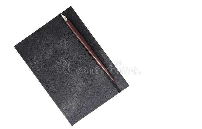 Book and nib pen. Fountain nib pen with black leather book put on wooden with space use for texts or products display stock image