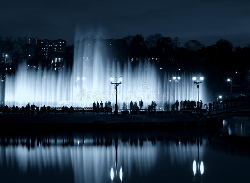 Fountain Night People Silhouettes Stock Image