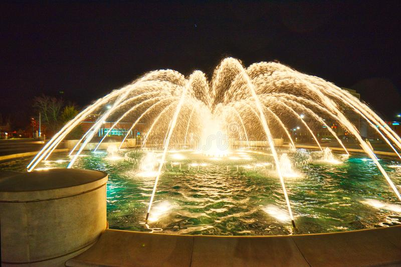 A composite image of 5 different exposures of a fountain at night. stock photography