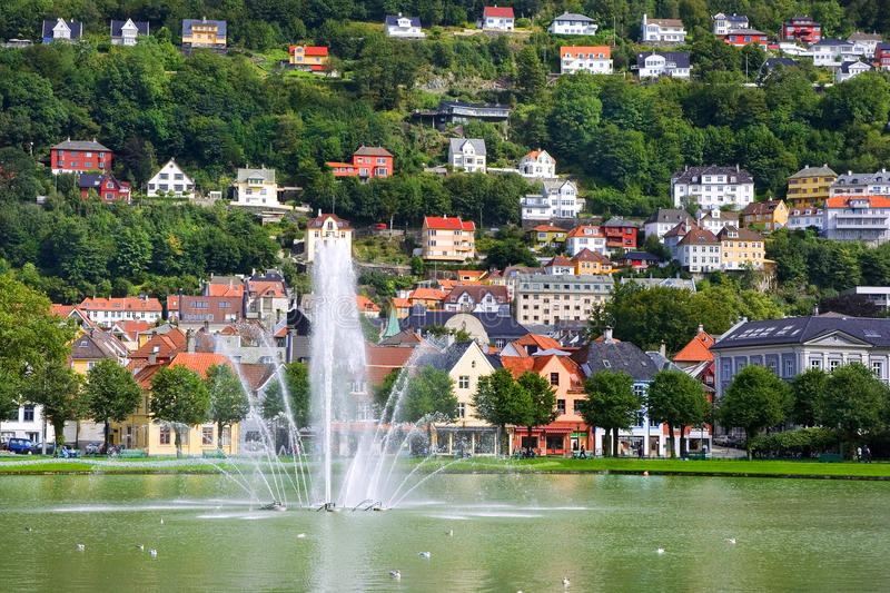 Fountain in old town with houses royalty free stock image