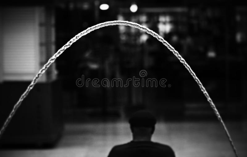A fountain over a man's head in Cleveland. Cleveland is a major city in Ohio on the shores of Lake Erie. Landmarks dating to its days as a turn-of-the-20th stock photography