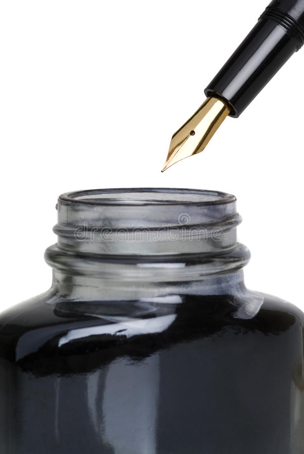 Fountain pen. And a ink bottle stock photos