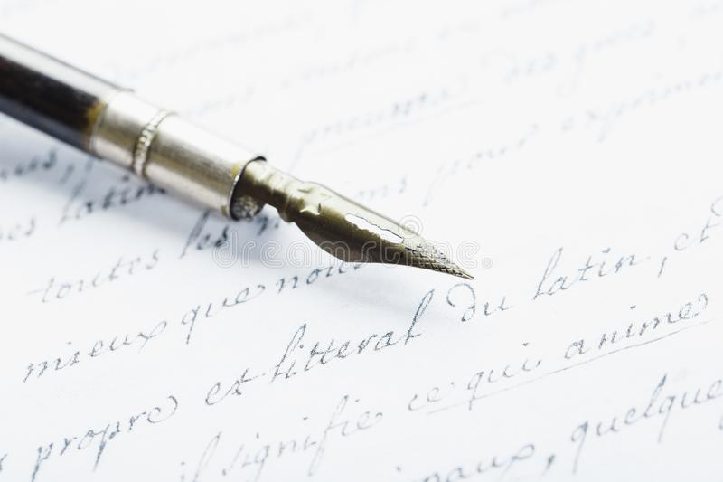 Fountain pen on an ancient handwritten letter. Old story. Retro style royalty free stock image
