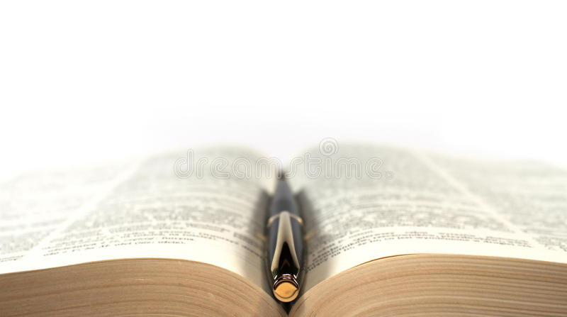 Fountain-pen on the book. Symmetrical composition, isolated royalty free stock photos