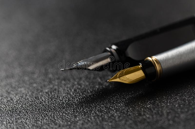 Fountain pen with clipping path on black background stock photography