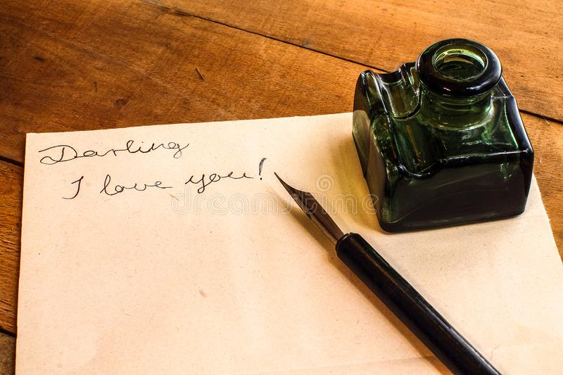 Fountain pen and ink bottle - Love letter. Fountain pen and ink bottle. Love letter. Valentine`s Day is coming royalty free stock photo
