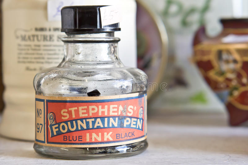 Fountain pen ink. NORTH BERWICK, SCOTLAND - APRIL 19 2014: A bottle of fountain pen ink on sale in an antique store in North Berwick stock photography