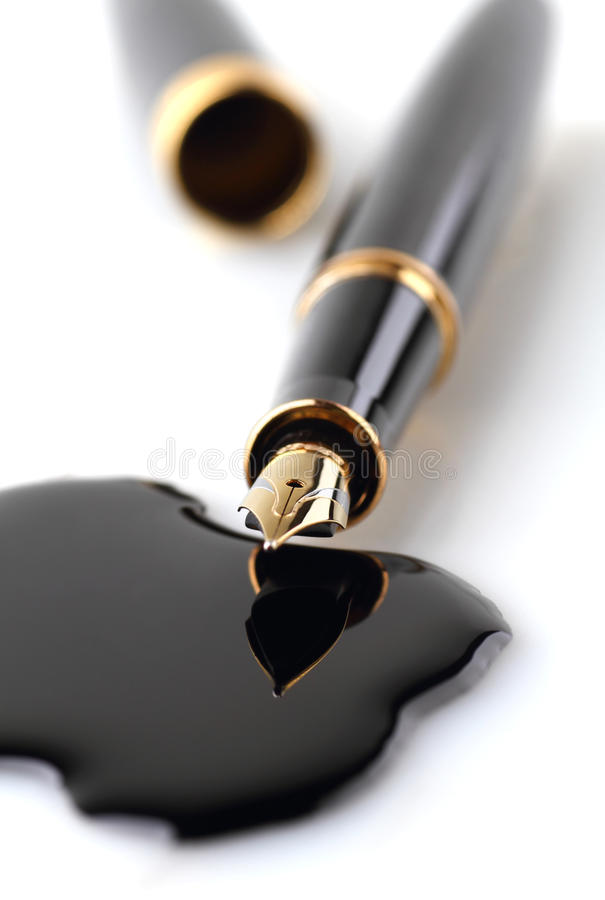 Fountain pen and ink spots. On white background royalty free stock image