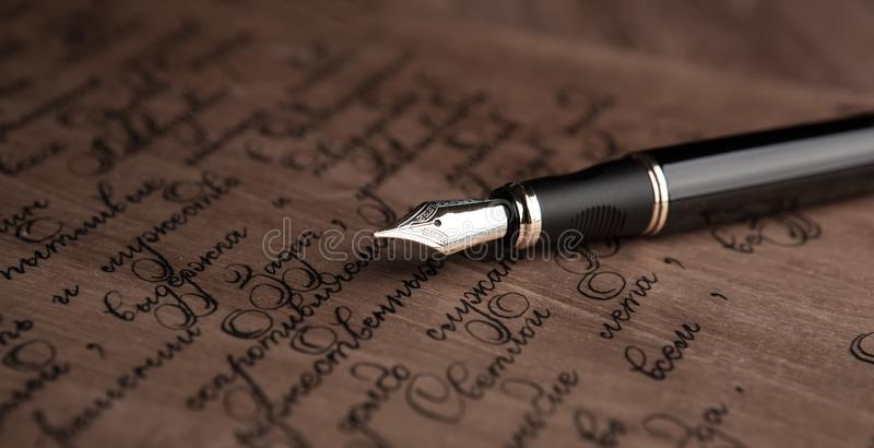 Fountain pen on letter with text vintage stock images