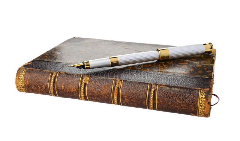 Fountain pen and old book stock photo