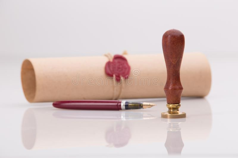 Fountain pen and old notarial wax seal on royalty free stock photography