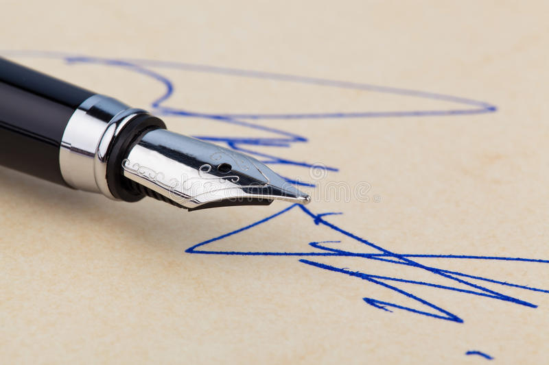 Fountain pen and signature royalty free stock photos