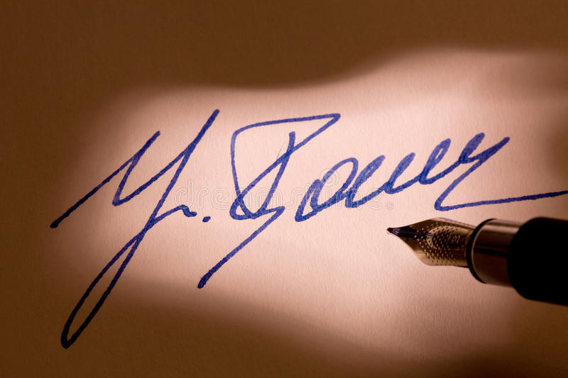 Fountain pen signature on a letter stock image