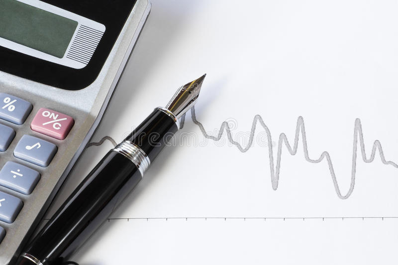 Fountain pen and stock chart royalty free stock photos