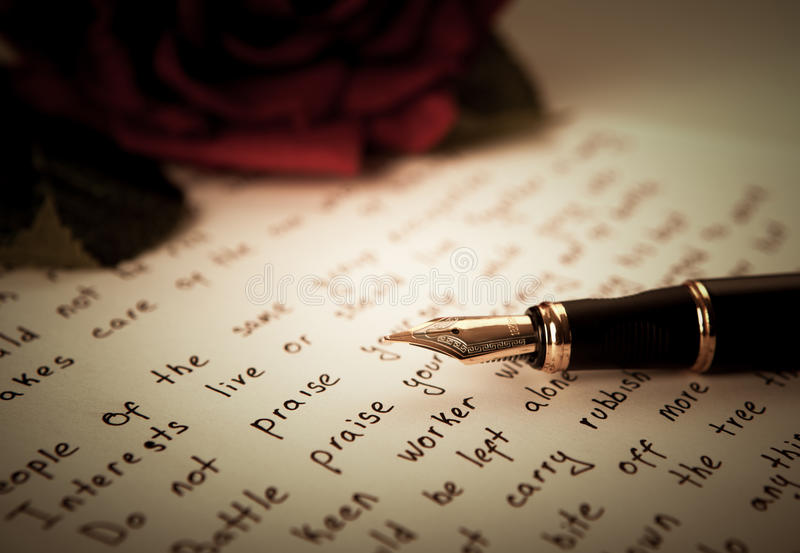 Fountain pen on text sheet paper with rose stock images