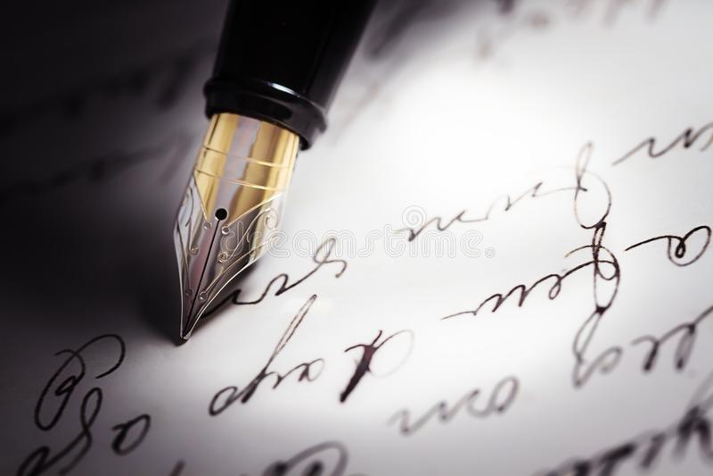 Fountain pen on top of a letter written in cursive stock photo pen writing letter fountain pen ink handwriting handwritten altavistaventures Images