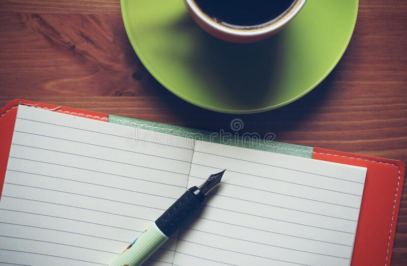 Fountain Pen On Top Of Notebook Beside Drinking Mug Free Public Domain Cc0 Image