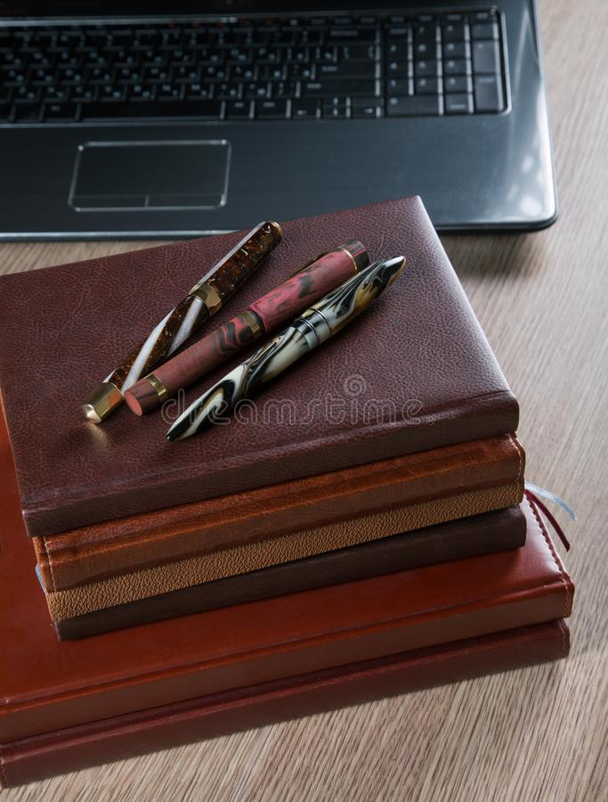 Fountain pens and diaries stock photography