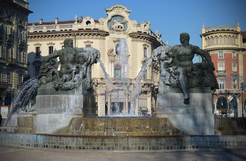Fountain in Piazza Solferino, Turin, Italy. Fountain and statues in Solferino Square in Torino, Italy (daytime stock images