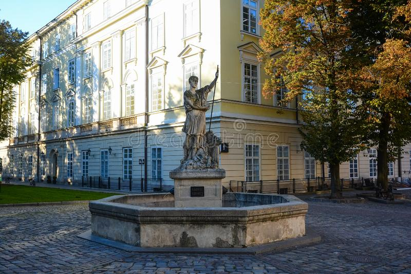 Fountain with sculpture of Greek god Adonis near the Square Rynok (Market) in Lviv, Ukraine. stock photos