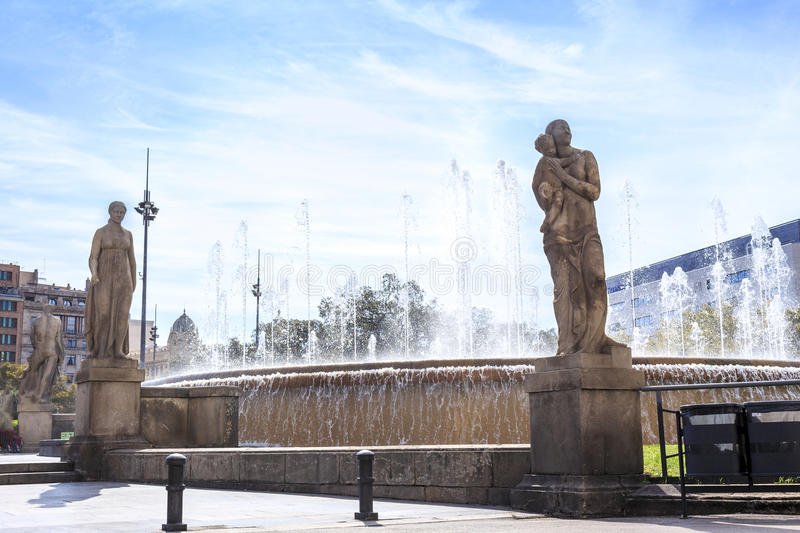 Fountain with sculptures on Placa de Catalunya, Barcelona, Spain royalty free stock image