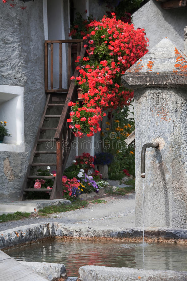 Fountain in a small village. Village well in Roch Molles, a small village in Piedmont stock image