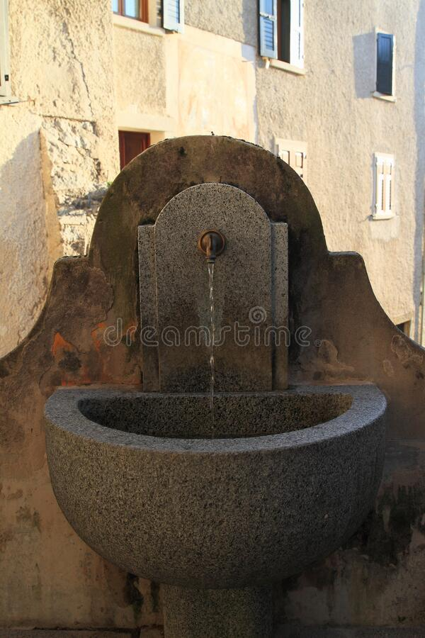 Fountain with sprouting water in village Bodone stock photos