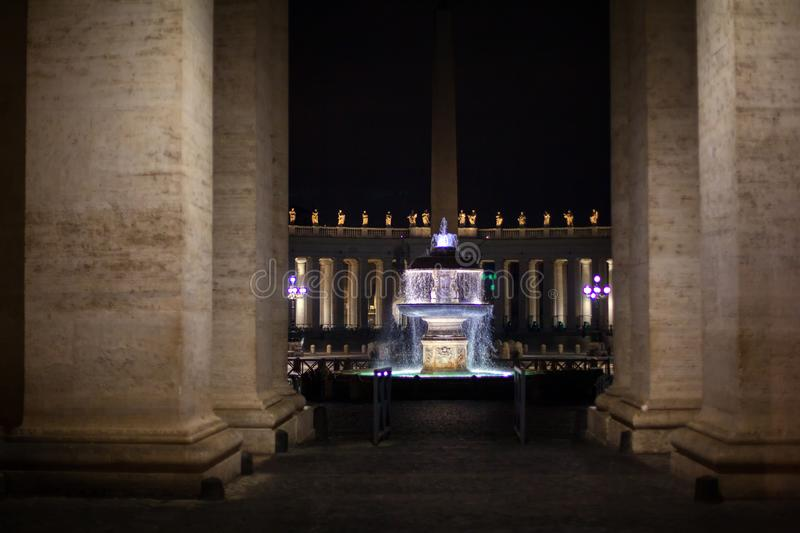 Fountain of St. Peter Square. In the night , Vatican royalty free stock image