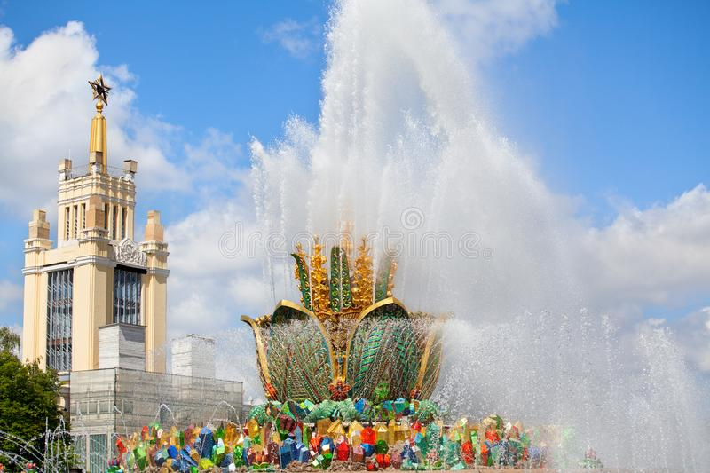 Fountain Stone Flower, Exhibition of Achievements of National Economy VDNKh in Moscow, Russia. Fountain Stone Flower on summer sunny day on blue sky and clouds stock photos