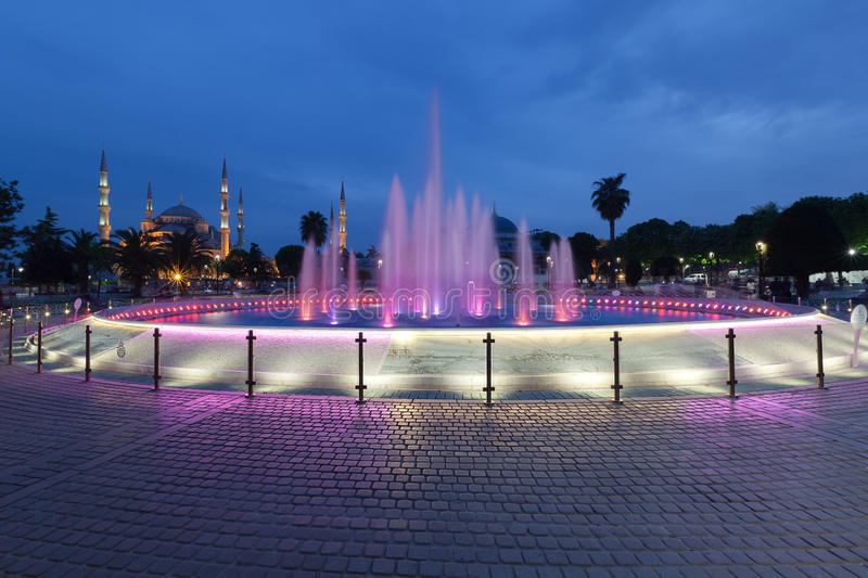 Fountain and the Sultanahmet Blue Mosque at night. Istanbul, Turkey stock photo