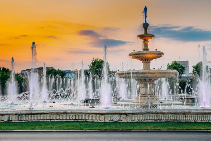 Fountain with sunset at Unirii Square in Bucharest, Romania. Orange sky royalty free stock image