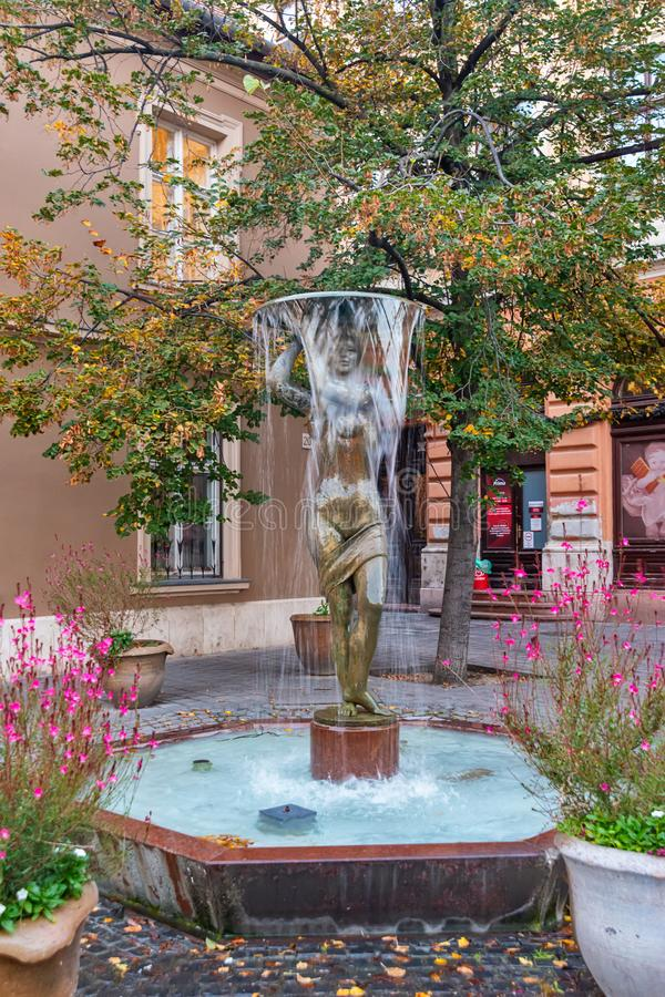 Fountain on Tarnok Utca in the old town castle district of Budapest, Hungary. Budapest, Hungary - October 01, 2019: Fountain on Tarnok Utca in the old town royalty free stock image