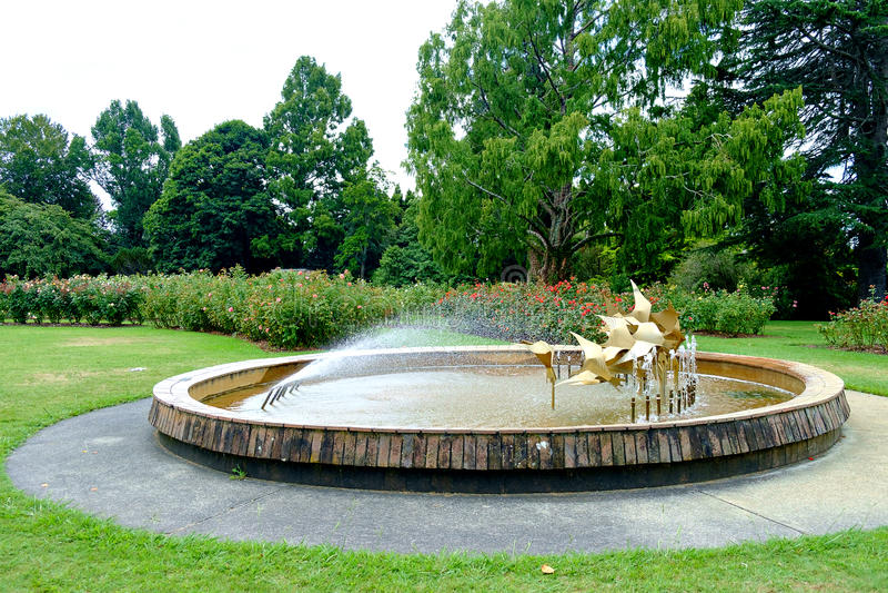 Fountain at Te Awamutu Rose Gardens, Te Awamutu, New Zealand, NZ, NZL. Popular feature of the rose gardens, the fountain symbolises a flight of birds landing on stock photo