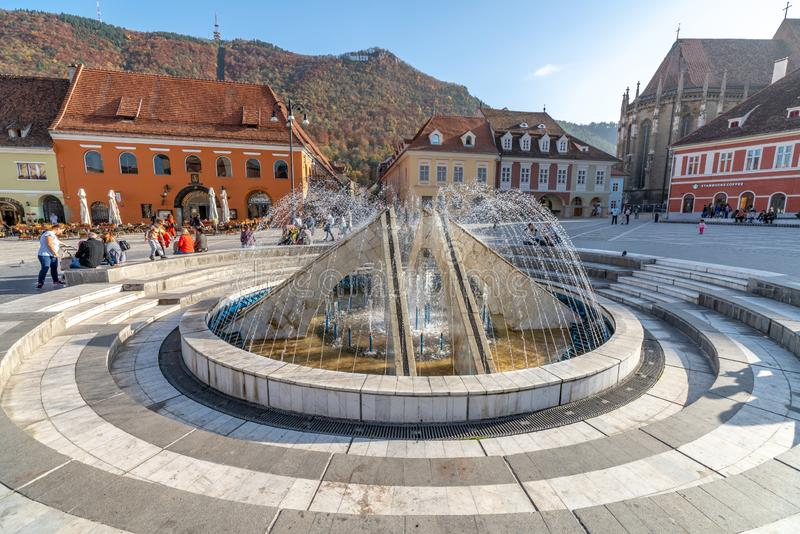 Fountain on the Town Hall Square of the Romanian Brasov. One of the ten largest cities in Romania. Located in the heart of Romania, the city of Brasov is royalty free stock image