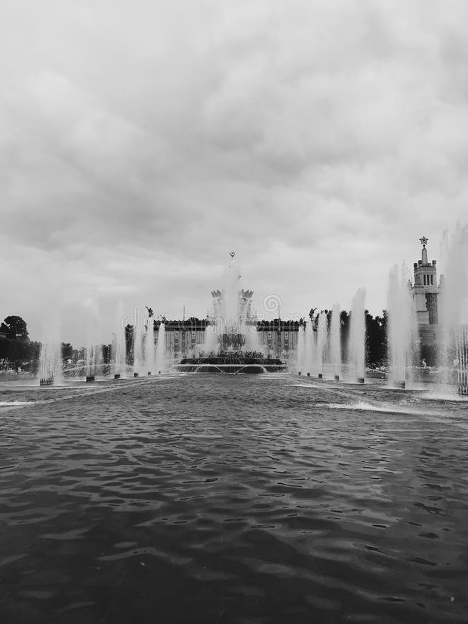 Fountain in VDNKH, Moscow. Photo of golden figures and statues of fountain in VDNKH in Moscow. Monument of USSR might and glory royalty free stock photo