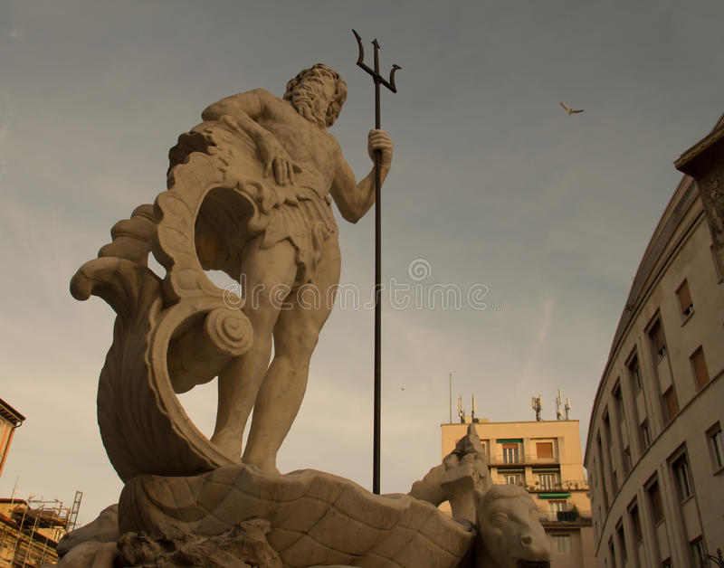 Fountain at Verdi Square, a statue of Poseidon with a trident, Trieste Italy royalty free stock images